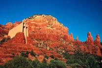 Chapel of the Holy Cross sits in between glowing red rock formations